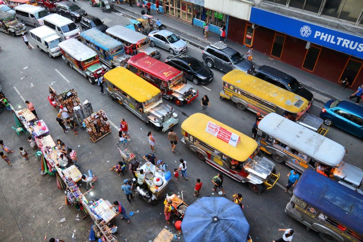 People drive in heavy traffic in Manila, Philippines