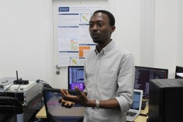 Dr Yusuf Sambo, University of Glasgow, demonstrating 5G communication technology. Image credit: Gail Wilson, University of Glasgow.