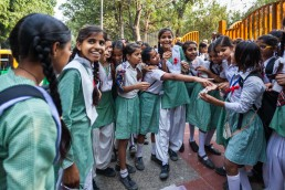 Indian schoolgirls choose souvenirs on the street, New Delhi, India.