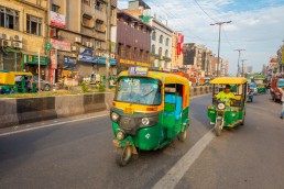 Green motorcycles in the avenue in Paharganj, Delhi. Credit: Fotos593 / Shutterstock.com