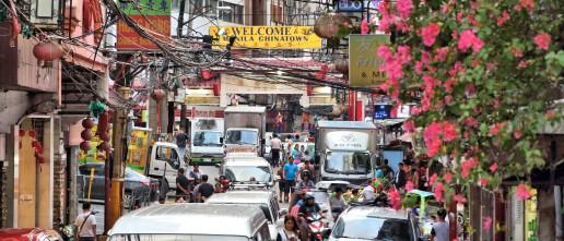 People visit Chinatown in Manila, Philippines. Credit: Tupungato / Shutterstock.com