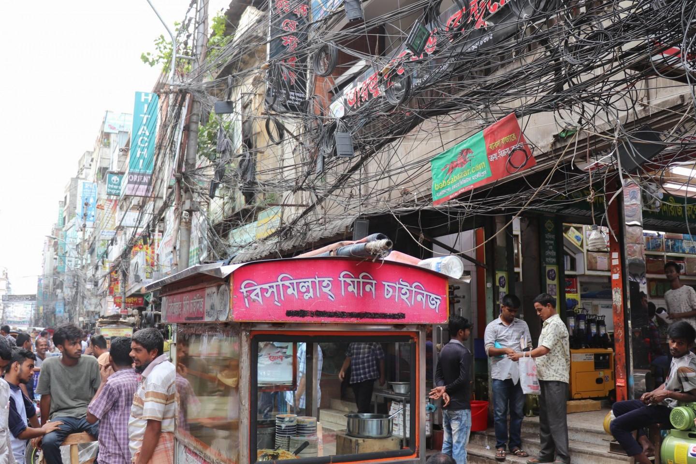 Busy life and risky tangled cables, Nawabpur Road, Dhaka. Credit: Khulna University.