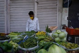 New Delhi, Delhi India- Vegetable vendors wearing masks and hand gloves while selling their items. Credit - Yogendras31, Shutterstock
