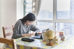 "On 18 February 2020 in Beijing in China, Xiaoyu starts the day at 8 AM. She logs in to an online platform launched by the Ministry of Education (MOE) and the Ministry of Industry and Information Technology. For those who have limited internet access, they will learn from TV. By 4 PM Xiaoyu will have attended six classes. Breaks and exercises are also part of the curriculum. Xiaoyu, an 11th grader in Beijing, is one of the hundreds of millions who is learning from home using her digital device and an internet connection. ""Compared with normal schooling, online learning is less effective to me. At school, I can approach teachers at any time if I have questions, and I can also discuss with my classmates,"" Xiaoyu says. ""I miss my friends,"" she says. ""We sometimes talk about the outbreak and when school will start. Staying at home for such a long time is so boring."" Xiaoyu continues, ""When I first learned the news about the postponing of spring semester, I was happy about the extended holiday. But now I just want to go back to school."" More than 180 million primary and secondary school students across China went online or switched on TV to attend class. The spring semester, originally scheduled to start on 17 February 2020, was postponed in an effort to contain the outbreak of the Novel Coronavirus (COVID-19). As of 29 January 2020 the emergence of the novel coronavirus has infected more than 6,000 people in China and other parts of the world since the outbreak began in Wuhan, China, in December 2019. Some cases of infection among children had also been reported. Investigations are ongoing to identify a zoonotic (animal) source of the infection, potentially from markets handling various animals. There is human-to-human transmission, including infection of health workers and close contacts. UNICEF China has been in regular contact with China's Ministry of Commerce, the National Health Commission, WHO, and other UN partners, as well as its regional"