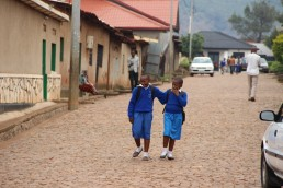 Two young school girls in uniform on their way home after class. Kigali, Rwanda. Credit: Sarine Arslanian