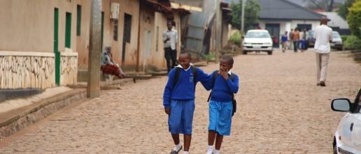 Two young school girls in uniform on their way home after class. Kigali, Rwanda. Credit: Sarine Arslanian