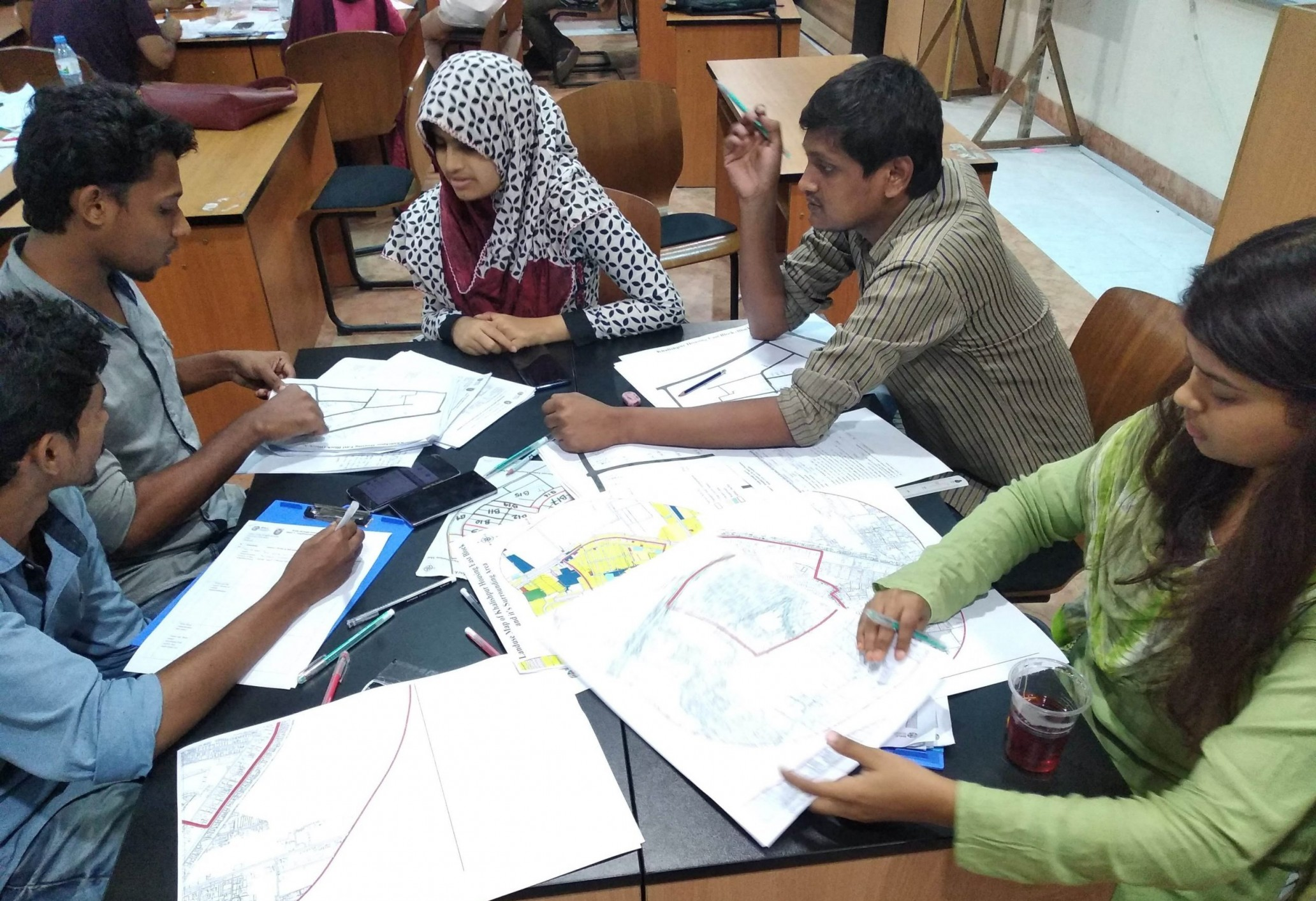 Students prepare data sheets from their field data sheets under the supervision of Nafisa Anjum, Research Associate. Credit: SHLC-BD