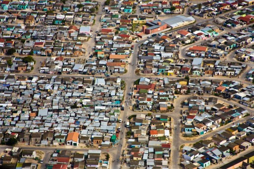 Aerial view of informal settlements of the Cape Flats, Cape Town, South Africa. Shutterstock - Andrea Willmore