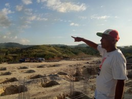 Figure 3: An indigenous resident points to the golf course where their spiritual mountain called Mount Kanuman was once situated