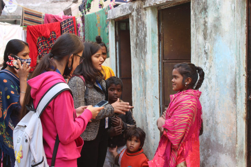 Researchers talking to young girl.