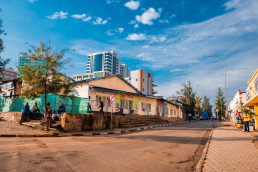 Street scene with labourers waiting to start work. Kigali, Rwanda. Credit: Shutterstock, Jennifer Sophie