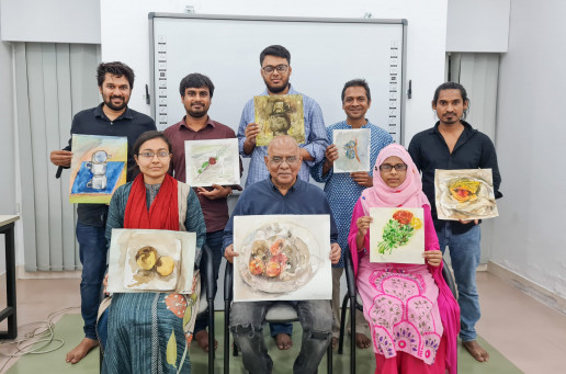Participants and their selected art works with Mr Kabir sitting in the middle. Credit: Shilpi Roy