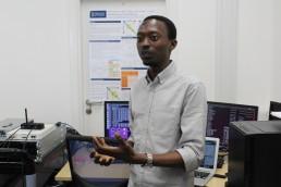 Dr Yusuf Sambo, University of Glasgow, demonstrating 5G communication technology. Image credit: Gail Wilson, University of Glasgow.