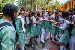 Indian schoolgirls choose souvenirs on the street, New Delhi, India.