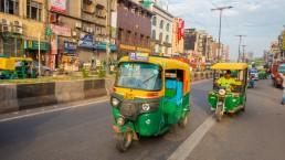 Green motorcycles in the avenue in Paharganj, Delhi. Credit: Fotos593 / Shutterstock.com