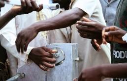 Gathering around a water pump, Nigeria. Credit: World Bank