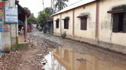 Waterlogged and muddy internal road without drainage facilities hindering the daily life of people in Hatimara, Dhaka. © 2020 SHLC Bangladesh