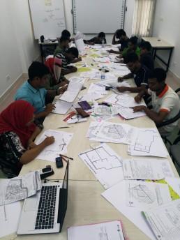 Students at Khulna University prepare data sheets for GIS analysis. Credit: SHLC-BD