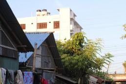 Two different roofs under the same sky, Goalkhali Bastuhara Colony, Khulna, Bangladesh. Credit: Irfan Shakil and Nishat Tasnim Maria