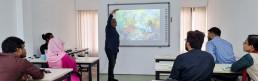 Eminent artist Mr. Kabir explaining his infamous painting 'The slum queen'. Credit: Shilpi Roy